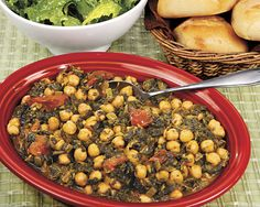 "CHICKPEAS WITH SPINACH: - Recipes at Penzeys Spices ~  ""You can vary the ratio of chickpeas to spinach to suit your taste or mood. It is cooked a long time, until the spinach is very well cooked. I make a large quantity so I can have an extra meal or a few lunches."" This dish also freezes well, or is easy to cut in half if you'd like a smaller batch."