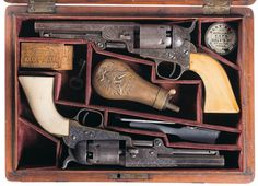 Cased Pair of Factory Engraved Colt Model 1849 Pocket Percussion Revolvers.