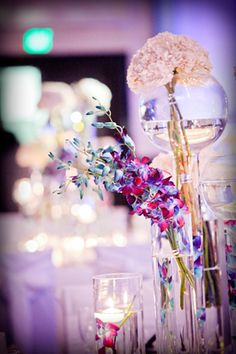 Blue, purple and white glass centerpieces | Photo: Emily Harris Photography