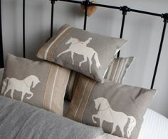 hand printed mink trotting horse cushion. I bet I could make these.