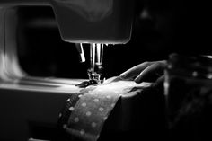 Seamstress high contrast black and white photograph of child