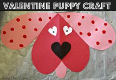 t out a smaller black heart for the nose and two little white hearts for the eyes. dog valentines day craft for kids Glue all the paper together and cut out a small pink oval to make a dog tongue sticking out! Add two dots on the eyes with black marker. cute dog valentines day craft If you want to make your dog have spots, grab some red paint and have the kids dip their point