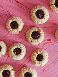 Peanut Butter & Jelly Potato Chip Thumbprint Cookies (recipe) Mmmm..