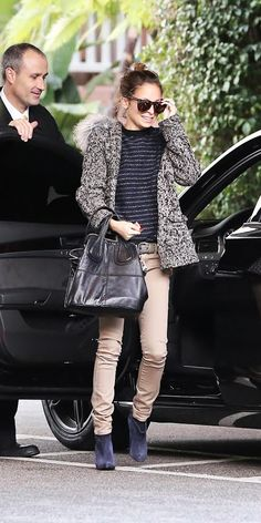 Nicole Richie wearing a Lanvin coat, Proenza Schouler sweater, Ksubi jeans, Givenchy Nightingale satchel, and Balenciaga boots