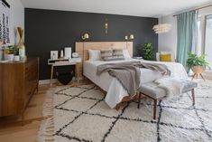"""The master bedroom accent wall is painted in """"Ebony Field"""" by Valspar."""