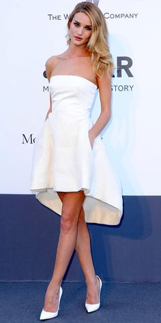 Rosie Huntington-Whiteley paired Christian Dior's silk bustier and skirt with white Christian Louboutin stilettos in Cannes.