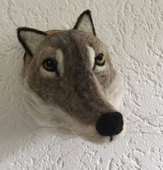 I use the technique of needlefelting and wetfelting. All the materials are natural. I carefully select wool from different sheep breeds. The head is mounted on a piece of wood, which has a hole in the back for easy mounting to the wall with a little nail. Dimensions:15x14x 21 cm You will
