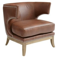 Klismos-style wingback chair in cognac bonded leather with silver nailhead trim  Product: ChairConstruction Material...