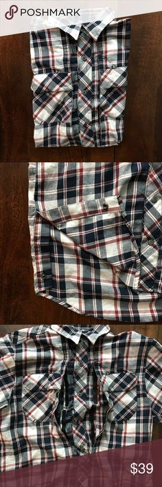"""Under Armour • men's utility shirt Under Armour • flannel utility shirt • shirt sleeve • velcro openings on the front of the shirt • velcro pockets • snaps at the bottom corners • all measurements were taken flat and are approximate: pit to pit : 21"""" 