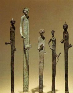 Etruscan elongated bronze figures from Volterra, 2nd-3rd century BCE at the Museum of VIlla Guilia, Rome. Two are soothsayers, recognizable  by their gowns and pointed hats.