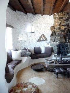 Charming space architecture interior home house design living room seating area built-in sofa whitewash Mediterranean Spanish stucco stone fireplace