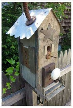 Repurposed house items make for an artistic birdhouse for your garden.