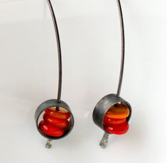 Oxidized silver frames. Dyed shell. Hand hammered sterling earwires. 1.5 inch overall length.