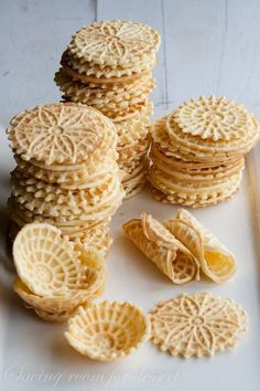 Italian Pizzele Waffle Cookies // Pizzelles are traditional Italian waffle cookies often vanilla, anise, or lemon zest. Pizzelle are popular during holidays and often found alongside other traditional Italian pastries such as cannoli. The cookie dough or batter is put into a handheld pizzelle iron or electric press. Pizzelle, while still warm, can also be rolled using a wooden dowel to create cannoli shells and cones. Delizioso! | pin @ Pizzele Italian Waffle Cookies Cookie Flavors, Cookie Desserts, Just Desserts, Cookie Recipes, Dessert Recipes, Gourmet Desserts, Picnic Recipes, Waffel Cookies, Pizzelle Cookies