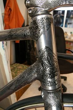 Intricately engraved bicycle. Probably didn't improve the fatigue life of this frame any, but it is amazing to look at.