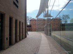 Fascinating modern architecture inside the walls of Nuremberg. The glass façade of the 'Neues Museum' is mirroring the old town wall. By the way the museum is about modern and contemporary art as well as design. Nuremberg Germany, Glass Facades, Museum Of Contemporary Art, Old City, Bavaria, Old Town, Day Trips, Old Things, Around The Worlds