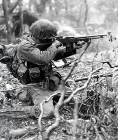 Guadalcanal. A marine shooting a Browning automatic rifle