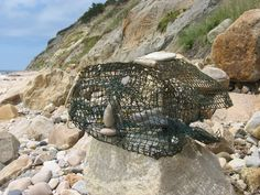 A washed up lobster pot, and beach combers can't resist crating art.