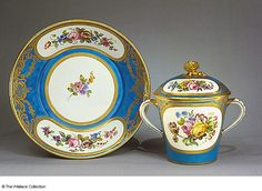 Two-handled Covered Cup and Saucer Gebelet 'à lait' et soucoupe of the second size Manufacture de Sèvres Sèvres, France 1774 Soft-paste porcelain, painted and gilded Cup with cover, Height: 12.9 cm Saucer, Diameter: 18.4 cm