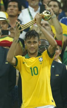Brazil's Neymar holds the golden ball trophy