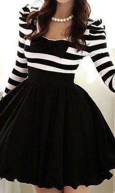I just love this black and white dress.