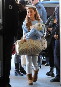 Ariana Grande with a Louis Vuitton travel bag matched with a baggy blue jumper and an Chanel bag washed out blue jeans and uggs to finish off the look Xx
