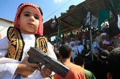 A boy holds a toy gun during a protest about a film ridiculing Islam's prophet Muhammad in the Palestinian refugee camp of Ain el-Hilweh near Sidon, Lebanon, Sept. 14, 2012.