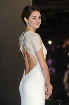 Shailene Woodley booty in a curve hugging backless white dress