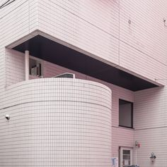 Hues of shame: tiled volume in Sueyoshicho, Yokohama, covered in pink reflection of the red light district house across the street.   © Jan Vranovský, 2016