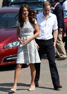 Kate looked the picture of summer perfect in a patterned white and beige Hobbs summer dress and low beige wedges. July 26, 2012
