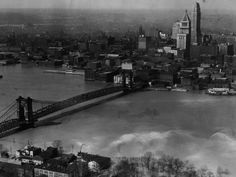 From the archives: Could '37 flood happen again? Photo: 1937: This aerial photograph taken above the Kentucky shore in 1937 shows the flood waters lapping at the Suspension Bridge, which was the only non flooded link from Pittsburgh to Cairo, Ill. Enquirer File Photo