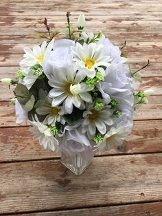 A personal favorite from my Etsy shop https://www.etsy.com/listing/507289838/3-daisy-and-rose-bouquets-in-white-and