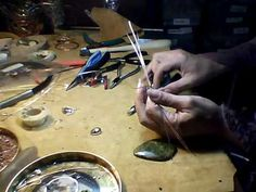 How to make a border wrap using round wire. great video using 18 guage copper round wire from hardware store and half round wire to make wrap around for large bead or cabochons..