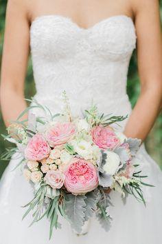 pink and peach wedding bouquet - photo by Koman Photography http://ruffledblog.com/modern-new-york-wedding-at-501-union #weddingbouquet #flowers