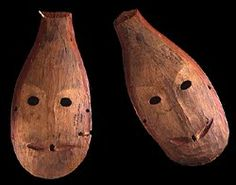 Paired gyrfalcon spirit masks. A narrow nose and triangular, upturned slits for a mouth gives these masks a bird-like appearance. The masks originally had eleven feathers. Each has a painted red line around the outside. Red color may have helped to protect the dancer from the spirit represented. These masks were collected by E.W. Nelson in Sabotnisky.          SI, 48987 (30.48 cm) and SI, 48988 (29.21 cm)