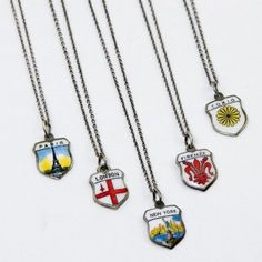 Limited edition c1940-70 vintage hand painted enamel shield charms are made of 800 silver, and come on a modern oxidized sterling silver chain with spring ring closure.