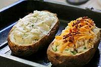 Twice Baked Potatoes ~ Twice baked potato recipes.  One with a cheddar cheese and bacon stuffing, the other with a blue cheese and chives stuffing. ~ SimplyRecipes.com