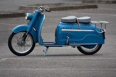 This beautiful scooter is a version of the DKW Hobby scooter built under licence by Manurhin, a French gun manufacturer. The company started building the Hobby back in 1956 under the name of the Manurhin MR75, known as the Concord in the UK. The Manurhin scooter models are apparently among the first motorcycles to have used powder coating paint techniques.  This one, with lovely French blue paint, is a 1961 version sold by Bonhams auction house in 2007, as part of the Peter McManus…