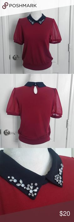 Japanese Red Top ☆Ingni deep red top with bejeweled black collar.  ☆This top was purchased at the Ingni store in Waseda Town in Oita, Japan.    ☆Size: M. For reference, the mannequin has a 33 inch bust and it fits it just fine. Can fit a US size small as well.  ☆Condition: Excellent. No stains, tears, or missing stones. Ingni Tops Blouses