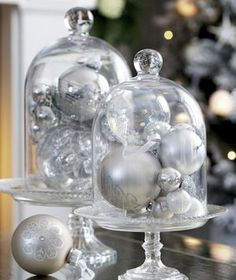 A sophisticated new use for your tree's décor. Gather balls, baubles, and bells together in cloches for an elegant table display. For a truly sophisticated look, stick to a single color palette. If you want your table to feel more merry and bright, mix it up with greens, blues, and reds.