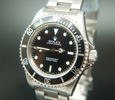 The Rolex Submariner 14060 Circa 2001 Mens Watch is truly a style classic.