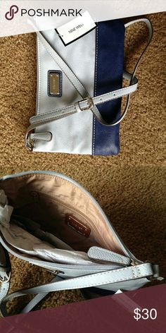 """*NEW* Nine West Crossbody Bag Faux leather material with small inner zipper. Outer zipper close. Color: Navy & periwinkle blue Size: 10.5""""x6.5"""" Strap: 47"""" Nine West Bags Crossbody Bags"""