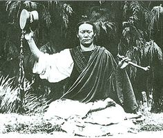 """A Tibetan yogin doing the Chod practice. The Chod ritual is to """"Cut through the ego"""". It is often done at a burial ground and the yogin recites the ritual while playing a two-sided drum and a thigh bone trumpet. The practice reinforces the truth of impermanence in this fleeting life. Image -early 20th Century."""