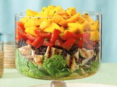 Layered Caribbean Chicken Salad - For a tropical theme party or casual buffet, this colorful creation will bring a ray of sunshine.