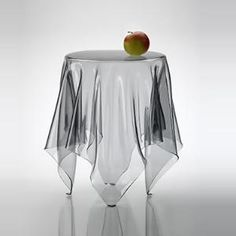 Ghostie Clear Side Table. (A little too modern for my taste but still pretty neat)