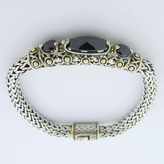 This is a beautiful 925 Sterling Silver Bracelet with black onyx and 14c gold.  This bracelet is inspired by John Hardy.   Weights: 35.80 gram.