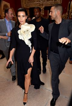 Kim Kardashian's Kraziest Klothes - Kardashian was in full bloom when she and new beau Kanye West shared their passion for fashion at Paris Haute Couture Fashion Week last July.