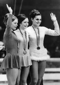 Peggy Fleming smiles on the podium, with Czech Hana Maskova (L) and East German Gabrielle Seyfert. Fleming won the gold medal.