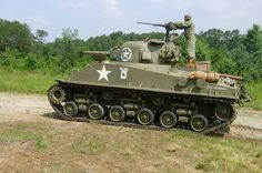 Sherman tank with hvss suspension.