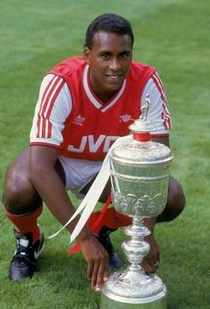 Portrait of David Rocastle of Arsenal posing with the Littlewoods Cup which Arsenal had won the season before during a photo-shoot held at Highbury, in London. Get premium, high resolution news photos at Getty Images Arsenal Players, Arsenal Football, Football Stadiums, Arsenal Fc, Football Team, Football Pics, Football Images, Football Memorabilia, Football Boots